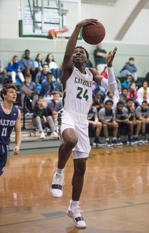 DJ McKenzie (24) shoots during the Walton vs Catholic basketball game at Catholic High School in Pensacola on Friday, January 25, 2019.