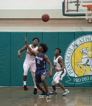 Kobi Jackson (5) passes the ball after stripping it during the Walton vs Catholic basketball game at Catholic High School in Pensacola on Friday, January 25, 2019.