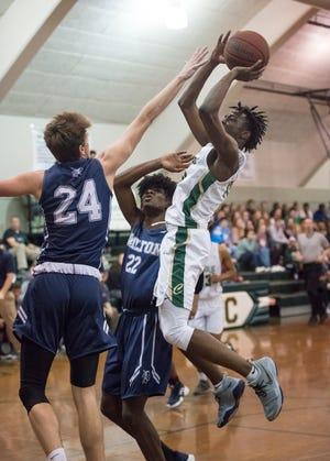 Kyree Merrill (10) shoots during the Walton vs Catholic basketball game at Catholic High School in Pensacola on Friday, January 25, 2019.