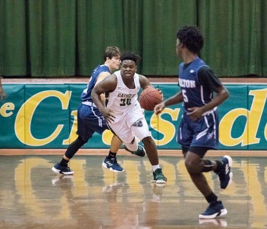 Waymond Jordan (30) brings the ball up court during the Walton vs Catholic basketball game at Catholic High School in Pensacola on Friday, January 25, 2019.