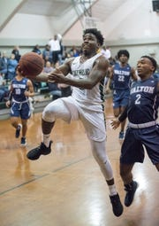 Kobi Jackson (5) leaps to the hoop during the Walton vs Catholic basketball game at Catholic High School in Pensacola on Friday, January 25, 2019.