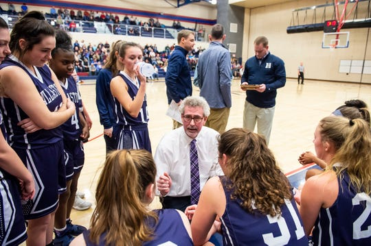 Dallastown head coach Jay Rexroth speaks with his team during a game against Spring Grove Friday, January 25, 2019. The Wildcats won 50-37.