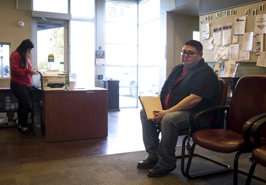 Jesse Bear Runner waits to apply for housing assistance, January 24, 2019, at the AZCEND office in Chandler.