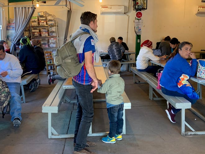 Jose Luis Rosa Valle and his 4-year-old Bruce sought help at the Kino Border Initiative on Jan. 25 after arriving to Nogales the day before to claim asylum in the United States. They fled Honduras because armed men were extorting and robbed them.