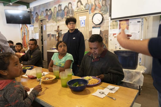 Brophy College Preparatory students serve food to migrants at a shelter in Nogales, Mexico.