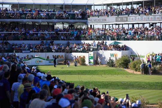 Phil Mickelson hits his tee shot on the 16th hole during the final round of the Waste Management Phoenix Open last year.