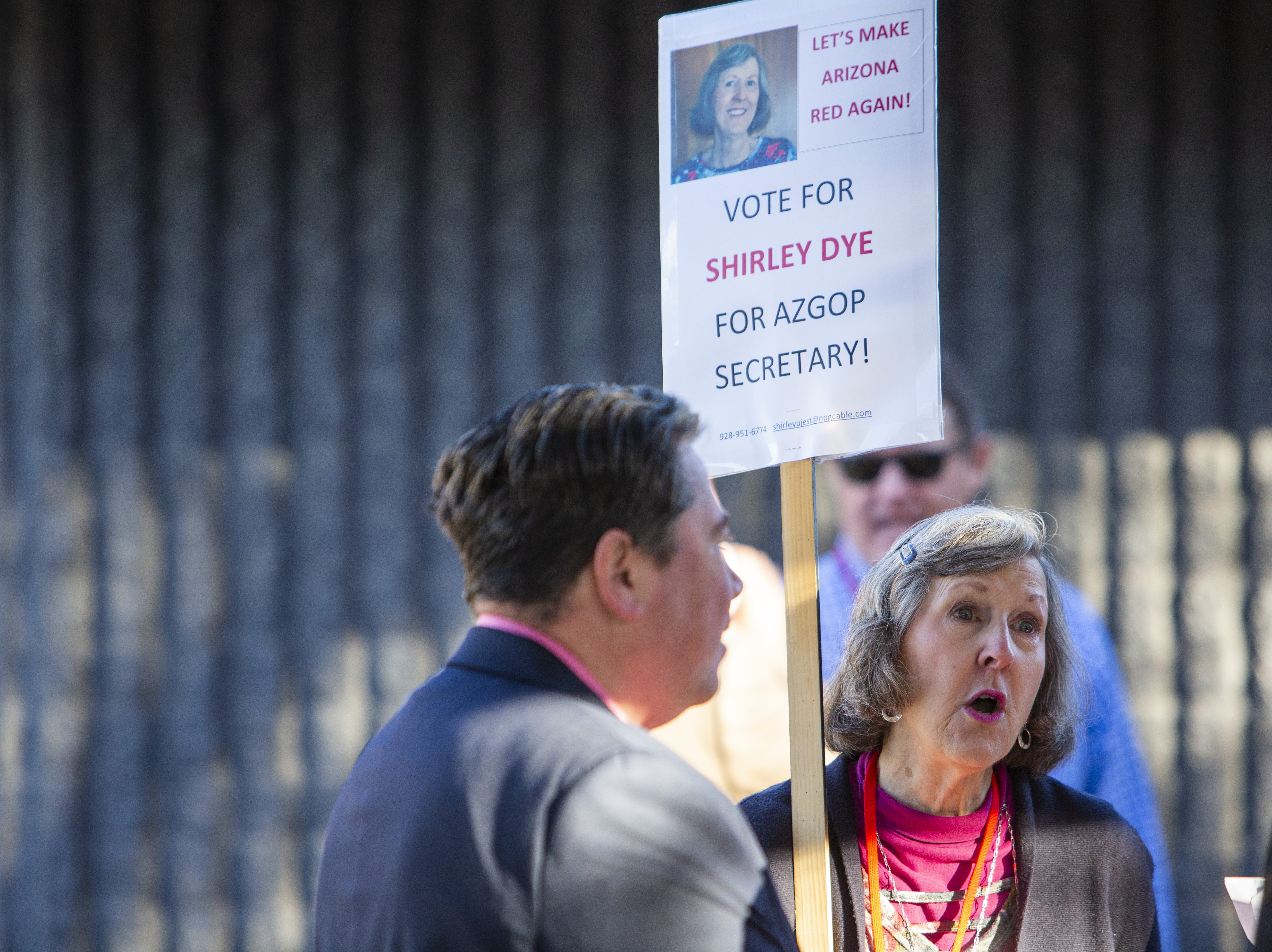 Shirley Dye, who is running for Secretary of the AZGOP, talks to people waiting outside the Church for the Nations where the Statutory Meeting of the State Committee of the Arizona Republican Party was held on Saturday, Jan. 26, 2019.