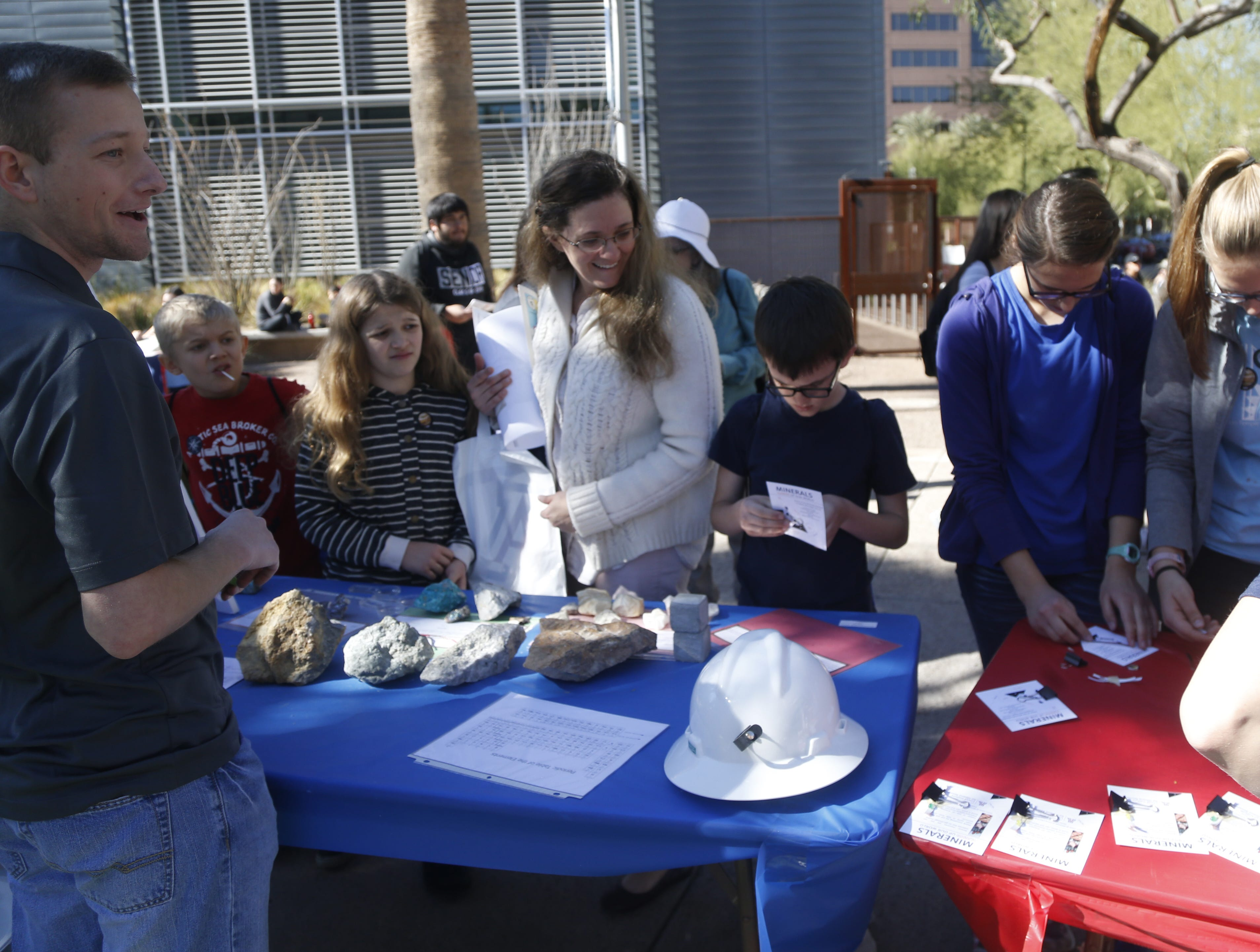 Children and adults explore the booths during a STEM outreach event in downtown Phoenix, Ariz. on January 26, 2019.