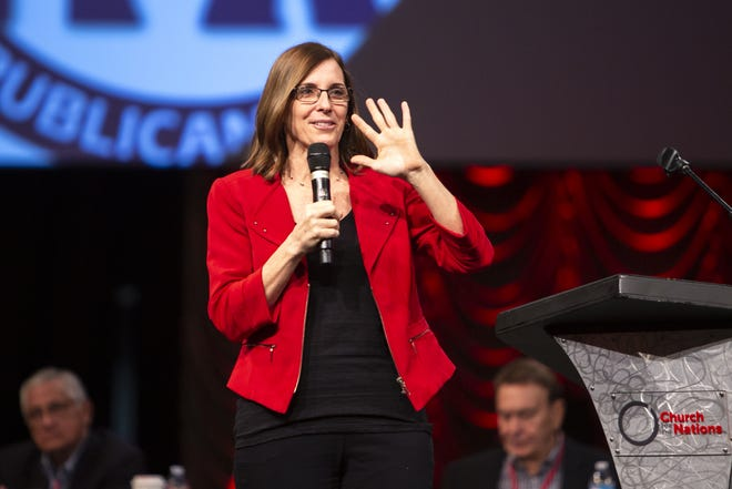Sen. Martha McSally waves at the crowd during the Statutory Meeting of the State Committee of the Arizona Republican Party at Church for the Nations on Saturday, Jan. 26, 2019.