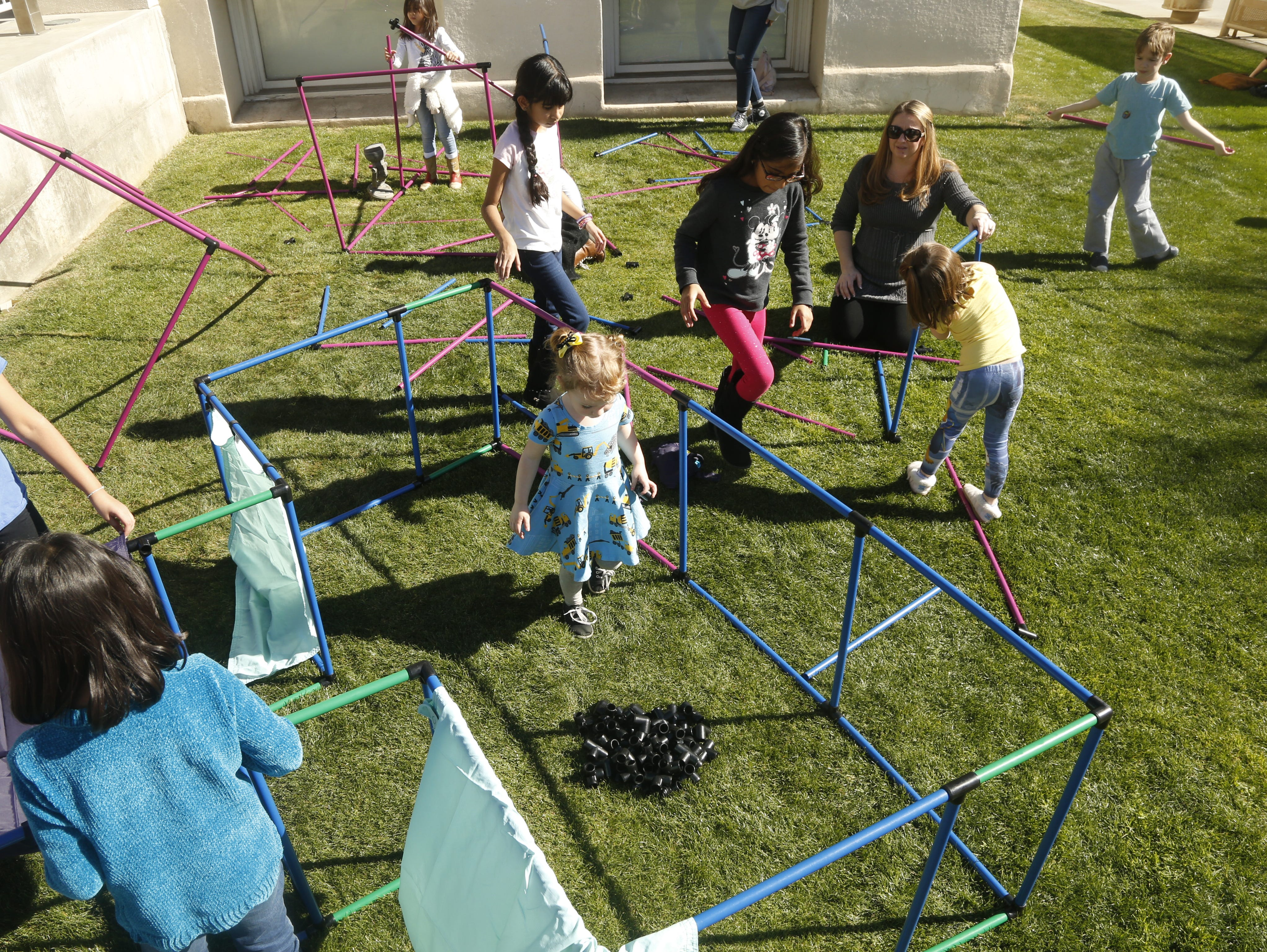 Children construct their own worlds with pieces and joints during a STEM outreach event in downtown Phoenix, Ariz. on January 26, 2019.