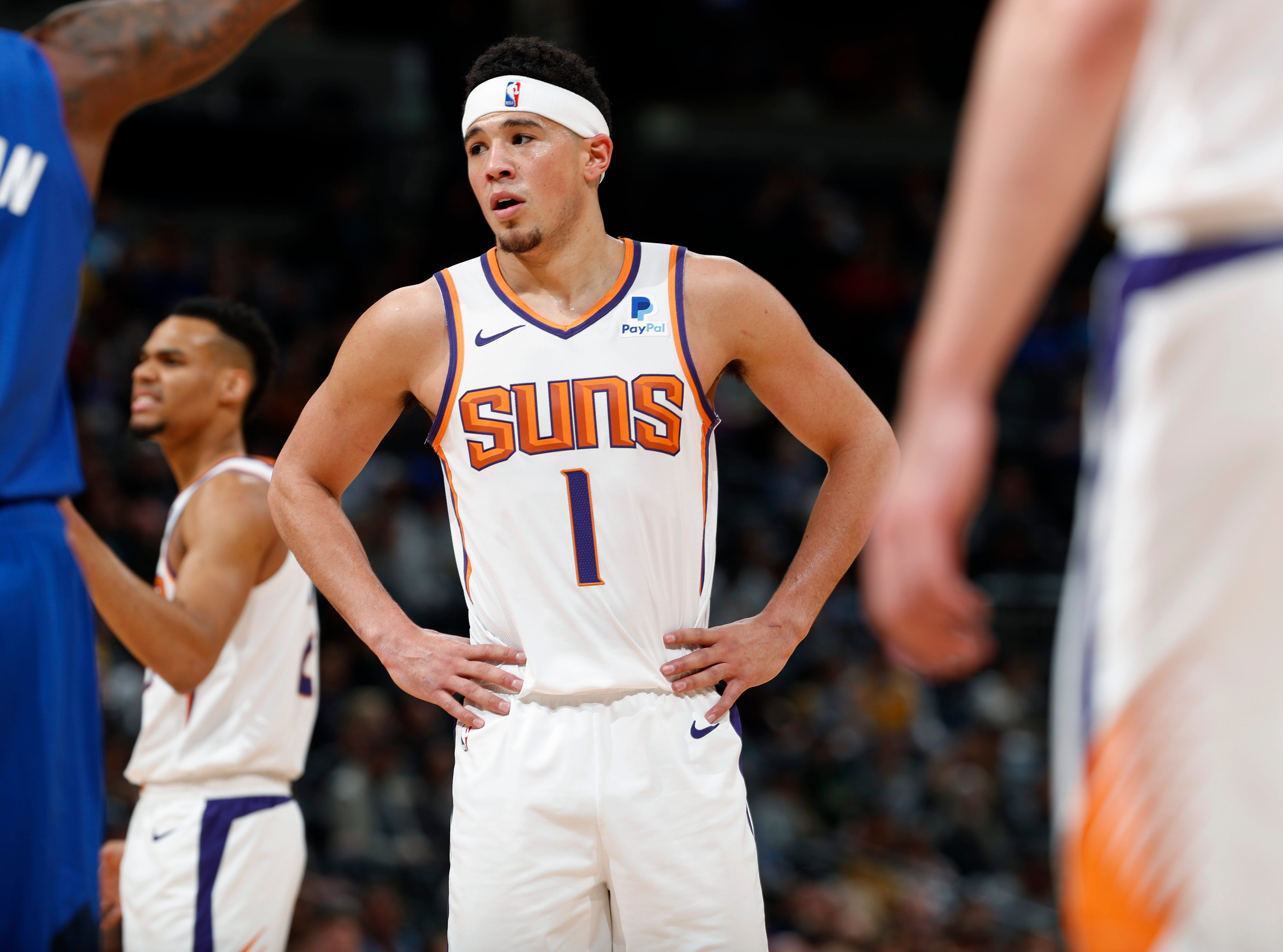 Phoenix Suns guard Devin Booker waits to shoot a free throw against the Denver Nuggets in the first half of an NBA basketball game Friday, Jan. 25, 2019, in Denver. (AP Photo/David Zalubowski)
