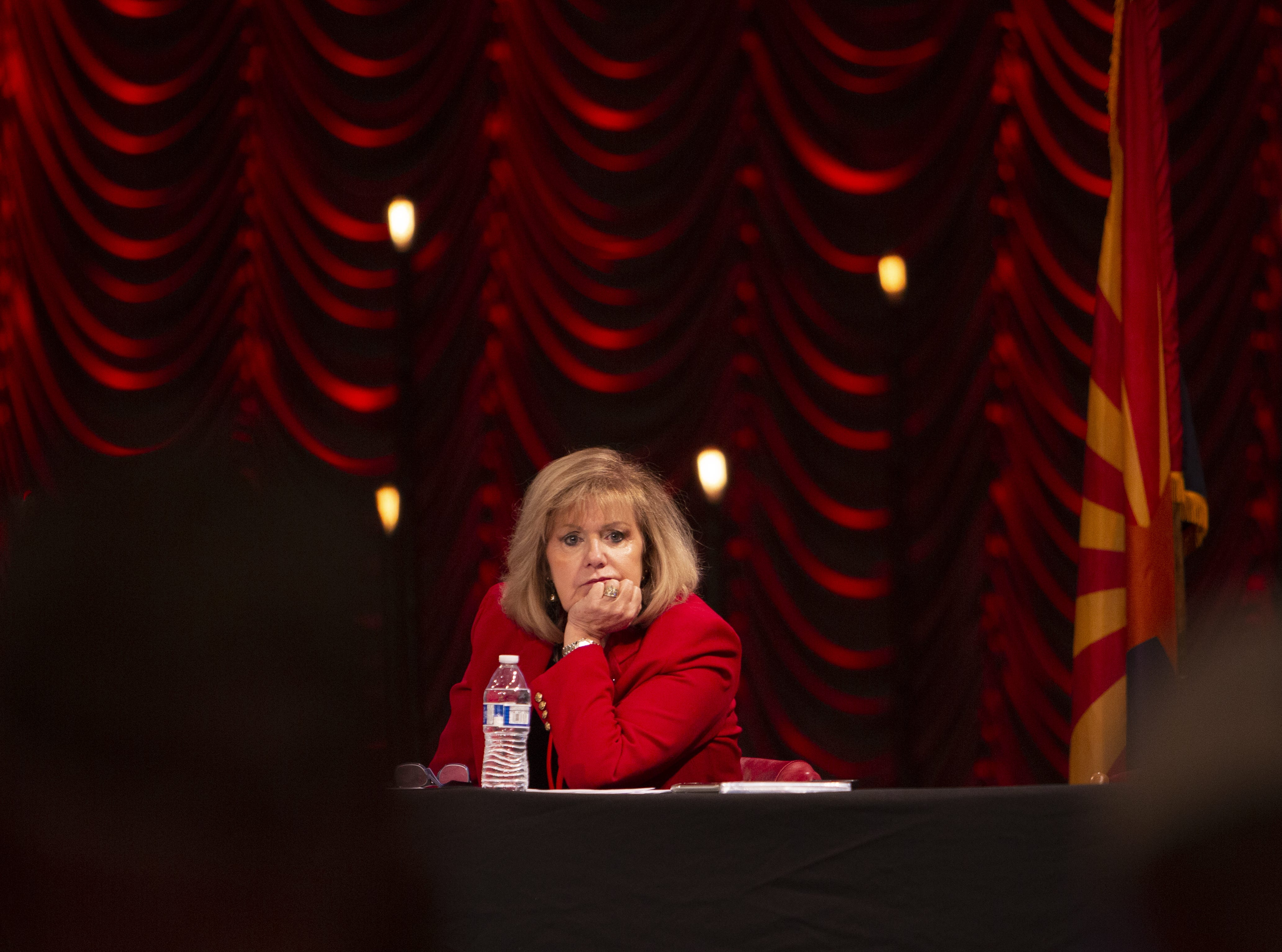 Lori Klein Corbin, the Arizona Republican National Committeewoman, listens to the Statutory Meeting of the State Committee of the Arizona Republican Party at Church for the Nations on Saturday, Jan. 26, 2019.