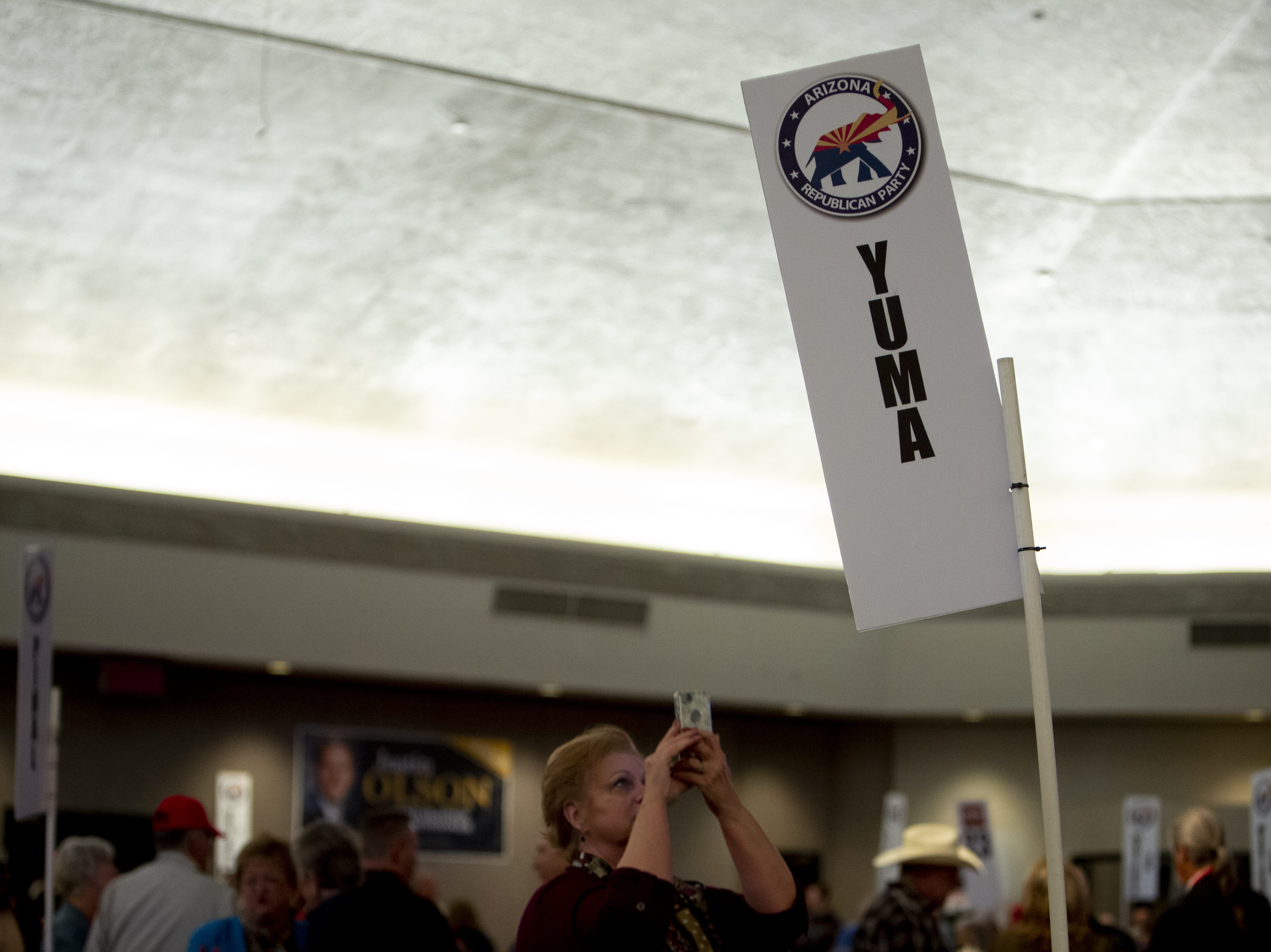 The crowd is divided into its districts with signs during the Statutory Meeting of the State Committee of the Arizona Republican Party at Church for the Nations on Saturday, Jan. 26, 2019.