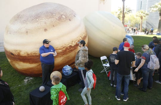 Taylor Shackelford, a volunteer docent, talks about the planets at a STEM outreach event in downtown Phoenix, Ariz. on January 26, 2019.