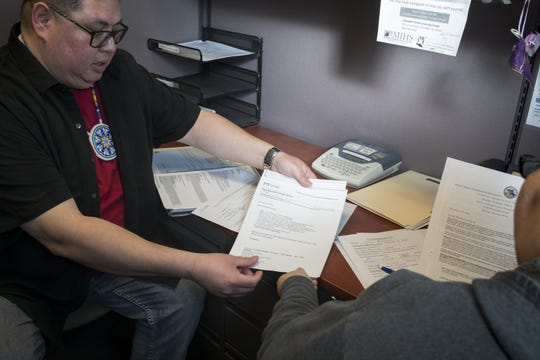 Jesse Bear Runner applies for housing assistance, January 24, 2019, at the AZCEND office in Chandler.