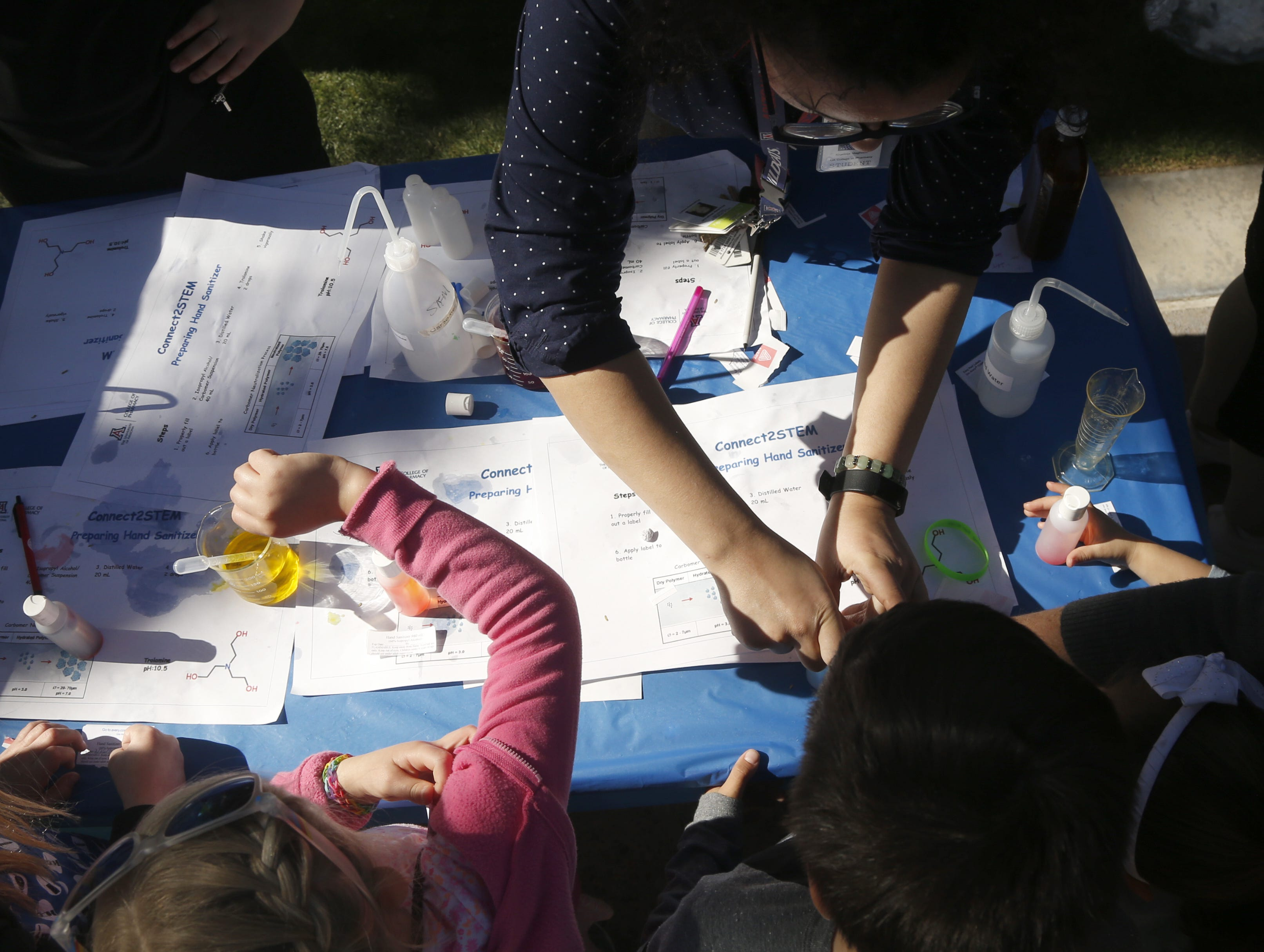 Children learn how to make hand sanitizer during a STEM outreach event in downtown Phoenix, Ariz. on January 26, 2019.