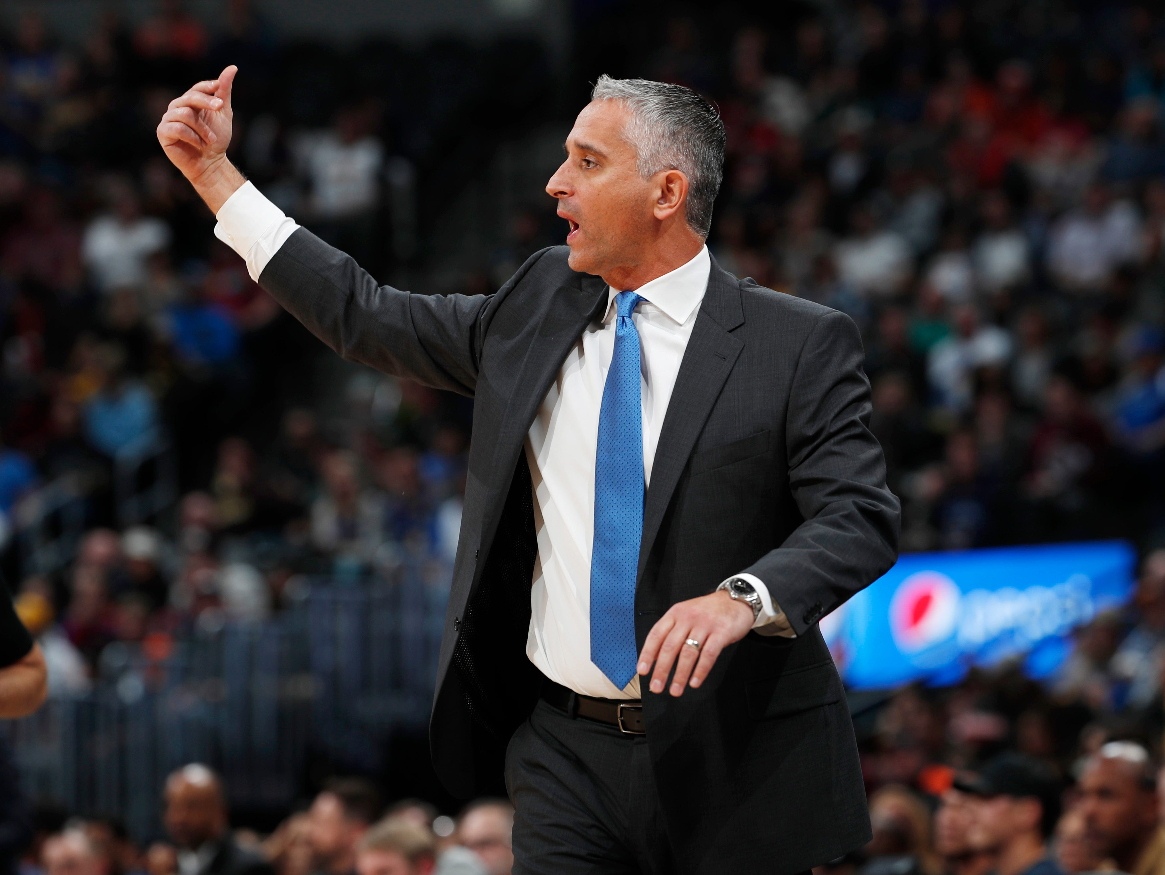 Phoenix Suns head coach Igor Kokoskov directs his team against the Denver Nuggets in the first half of an NBA basketball game Friday, Jan. 25, 2019, in Denver. (AP Photo/David Zalubowski)