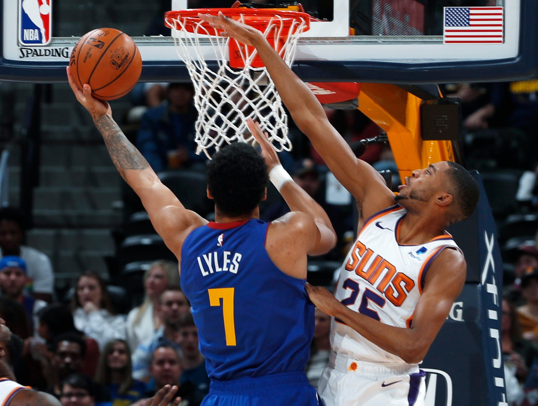Phoenix Suns forward Mikal Bridges, right, blocks a shot by Denver Nuggets forward Trey Lyles in the first half of an NBA basketball game Friday, Jan. 25, 2019, in Denver. (AP Photo/David Zalubowski)