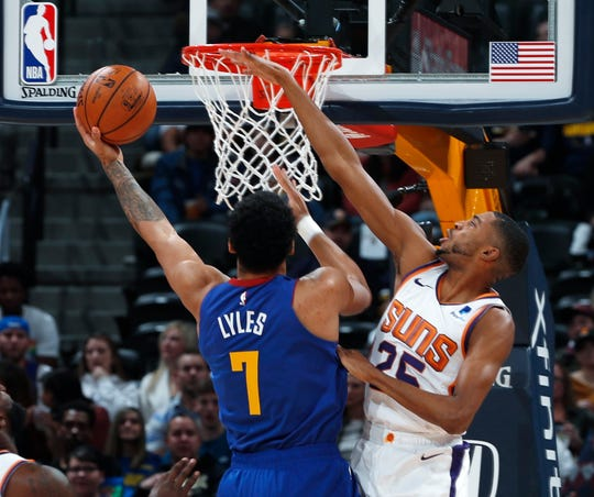 Mikal Bridges blocks a shot from Nuggets forward Trey Lyles during a game Jan. 25 at Pepsi Center.