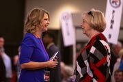 Kelli Ward, left, talks to an attendee of the Statutory Meeting of the State Committee of the Arizona Republican Party at Church for the Nations on Saturday, Jan. 26, 2019.