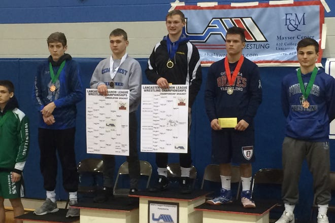 Colin Leonard of Northern Lebanon, center, brought home the L-L 126-pound title on Saturday. To Leonard's right is Cedar Crest's Taylor Gehman, who finished third.