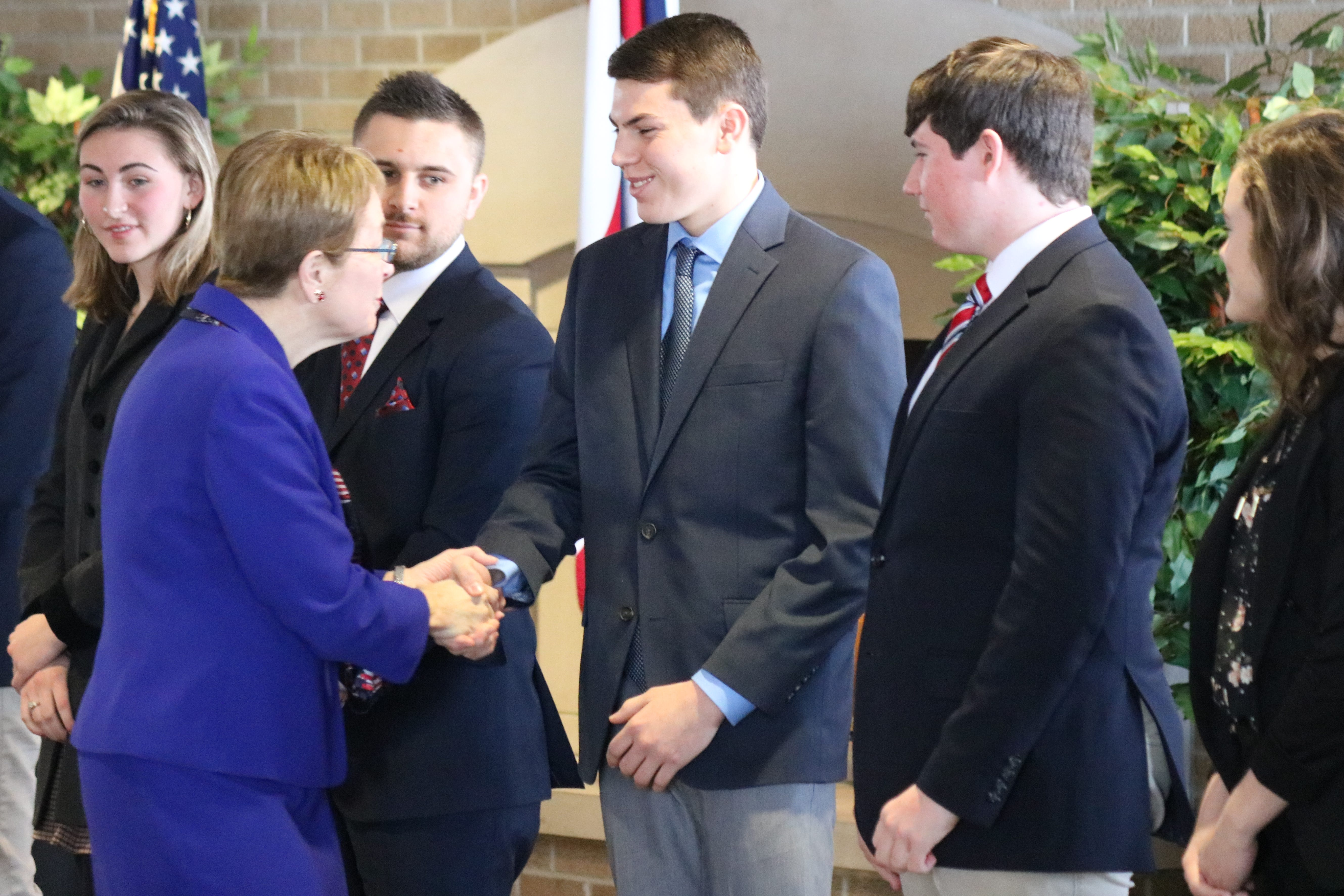 U.S. Rep. Marcy Kaptur, D-Toledo, congratulates the alternate service academy nominees for the Class of 2023 on Saturday at Camp Perry.