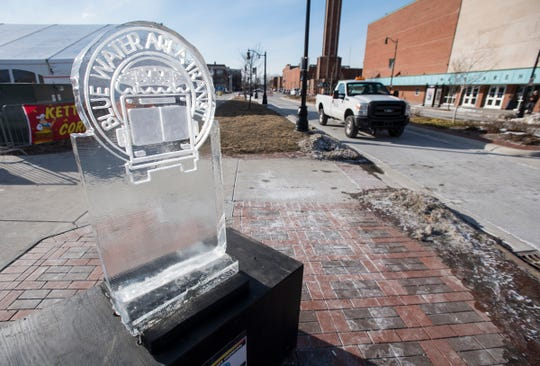 Ice sculptures for local businesses line the sidewalks in downtown Port Huron during this year's Chilly Fest.