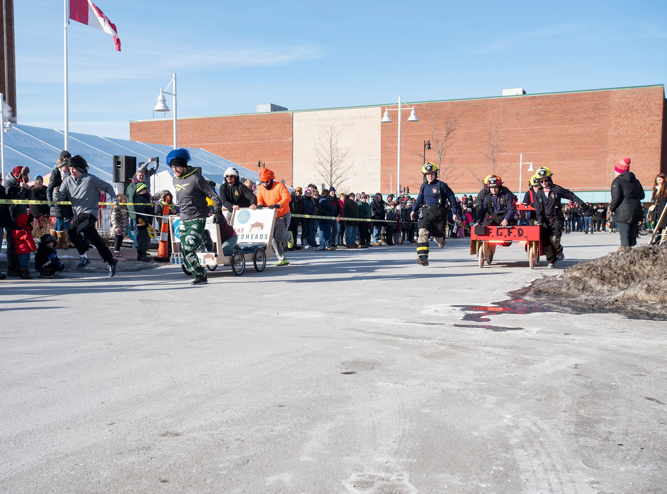 The Michigan Mutual team takes on the Fort Gratiot Fire Department Saturday, Jan. 26, 2019 during the annual Port Huron Chilly Fest bed races.