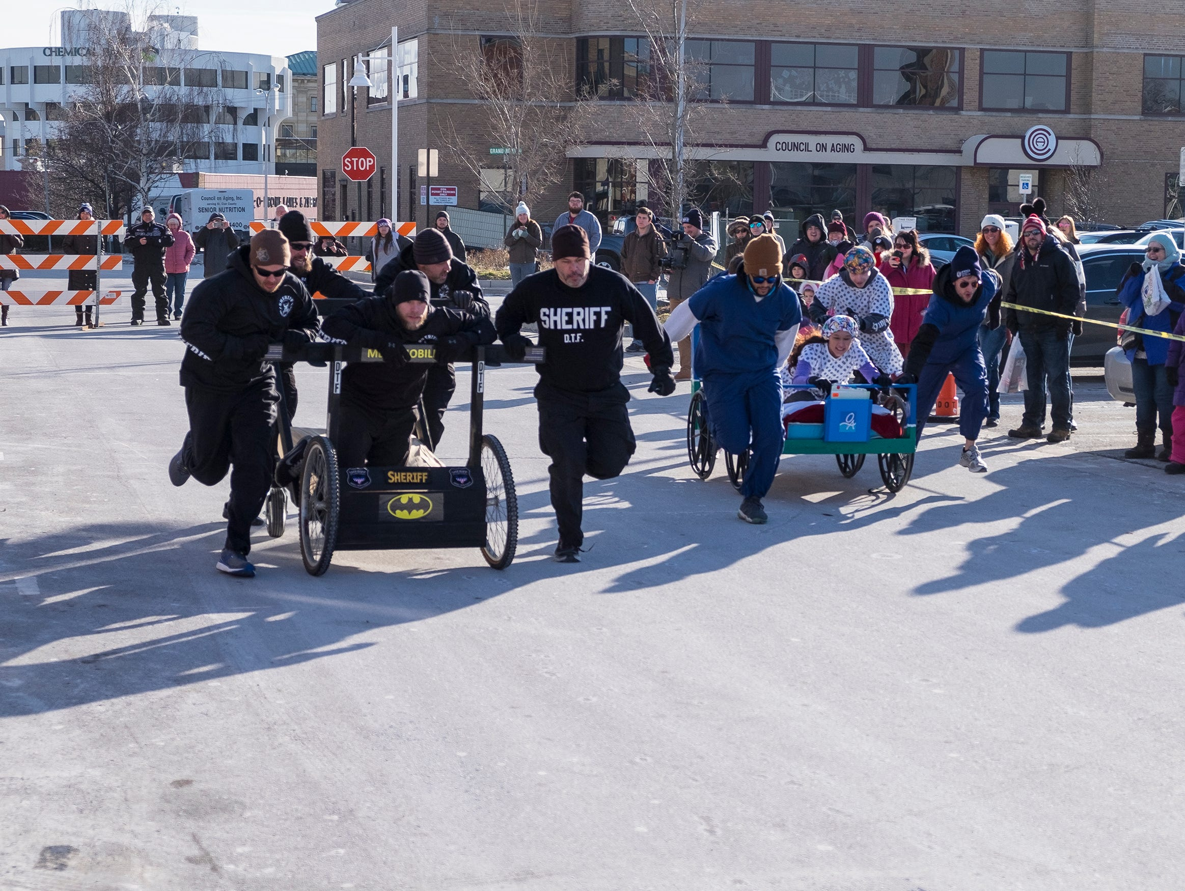 The St. Clair County Sheriff Department takes on the Orthopedic Associates team Saturday, Jan. 26, 2019 during the annual Port Huron Chilly Fest bed races.