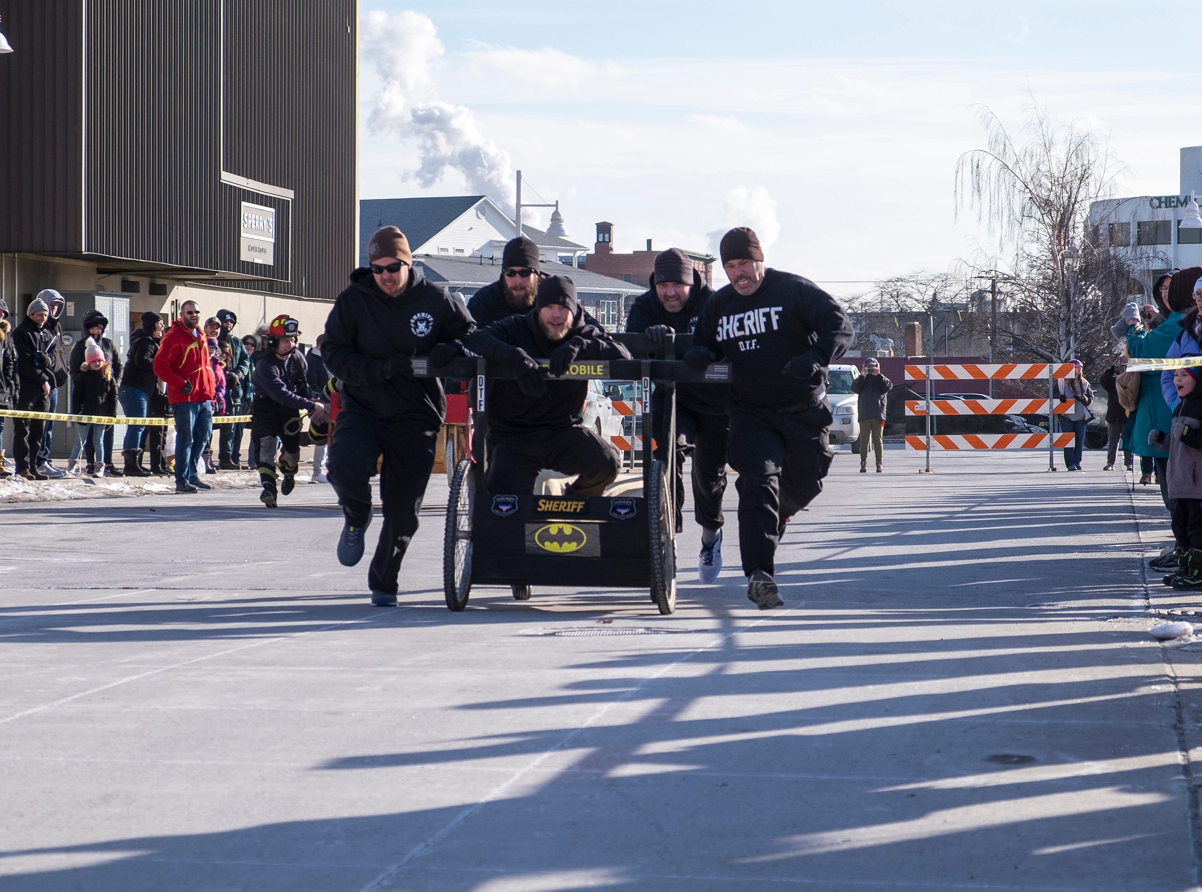 The St. Clair County Sheriff Department take on the Fort Gratiot Fire Department in a bed racing time trial aturday, Jan. 26, 2019 during the annual Port Huron Chilly Fest bed races.