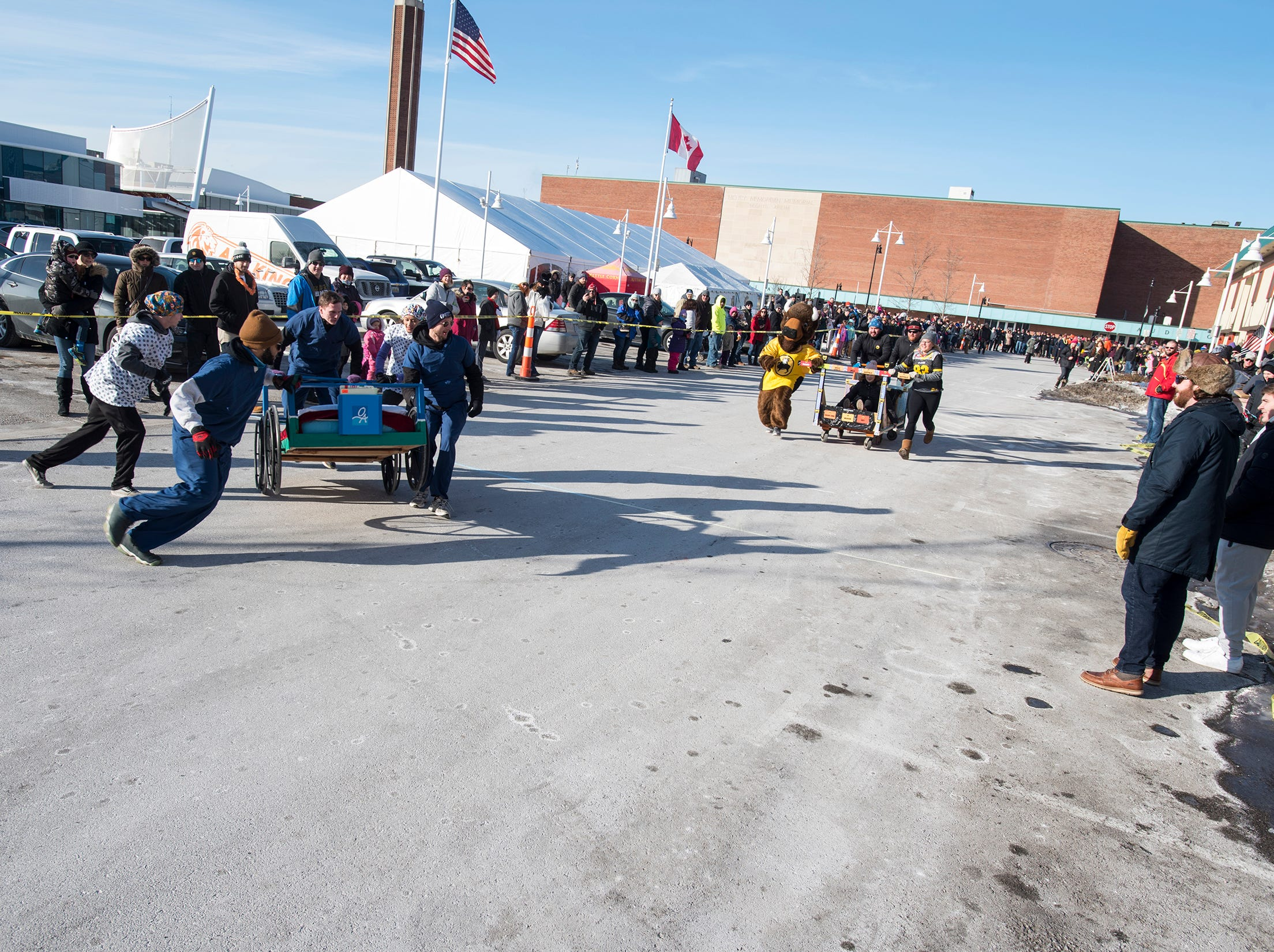 The Orthopedic Associates team takes on the Buffalo Wild Wings team in a bed racing time trial Saturday, Jan. 26, 2019 during the annual Port Huron Chilly Fest bed races.