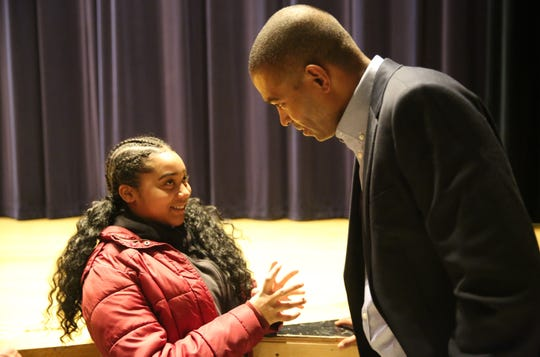 Morgan Watt (left), a 13-year-old eighth grader at Union Vale Middle School, talks with Rep. Antonio Delgado following his town hall on Friday night. She asked a question about safety in schools with recent acts of gun violence.
