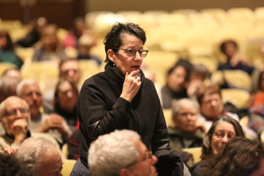 Carin Goldberg, 65, of Stanfordville, asks a question during a town hall for Rep. Antonio Delgado on Friday night. He spoke about issues related to border security and President Donald Trump's proposed U.S.-Mexico border wall.