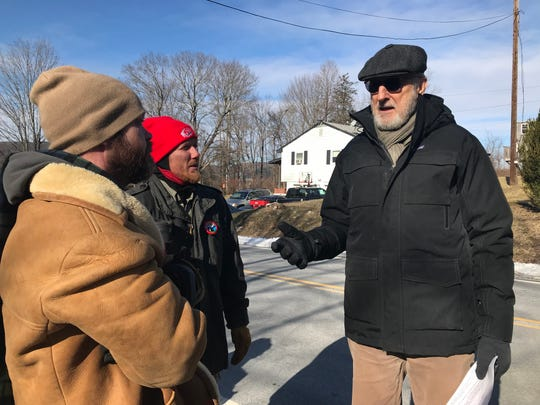 Actor and activist James Cromwell, right, talks with Joshua Douglass, left, and Jason Calabrese, center, both Millerton resident, before Saturday's protest against the development of Cricket Valley Energy Center in Dover.