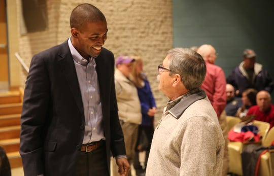 Antonio Delgado (left), D-19, speaks with Mike Herzog (left), 68, of Millbrook, before his first Dutchess County town hall on Friday night. He spoke about issues such as border security and the recently ended government shutdown.