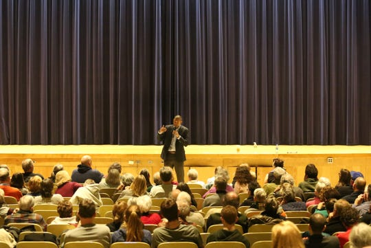 Rep. Antonio Delgado, D-19, addresses the crowd of a town hall in Stissing Mountain Junior-Senior High School in Pine Plains on Friday night. He spoke about several issues including border security and healthcare.