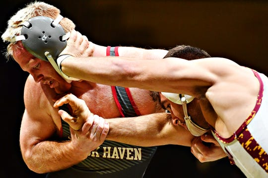 Lock Haven's Chance Marsteller, left, wrestles Arizona State's Josh Shields in the 165 pound weight class during NCAA Division I wrestling wrestling action at Red Lion Area High School in Red Lion, Friday, Jan. 25, 2019. Shields would win the match. Dawn J. Sagert photo