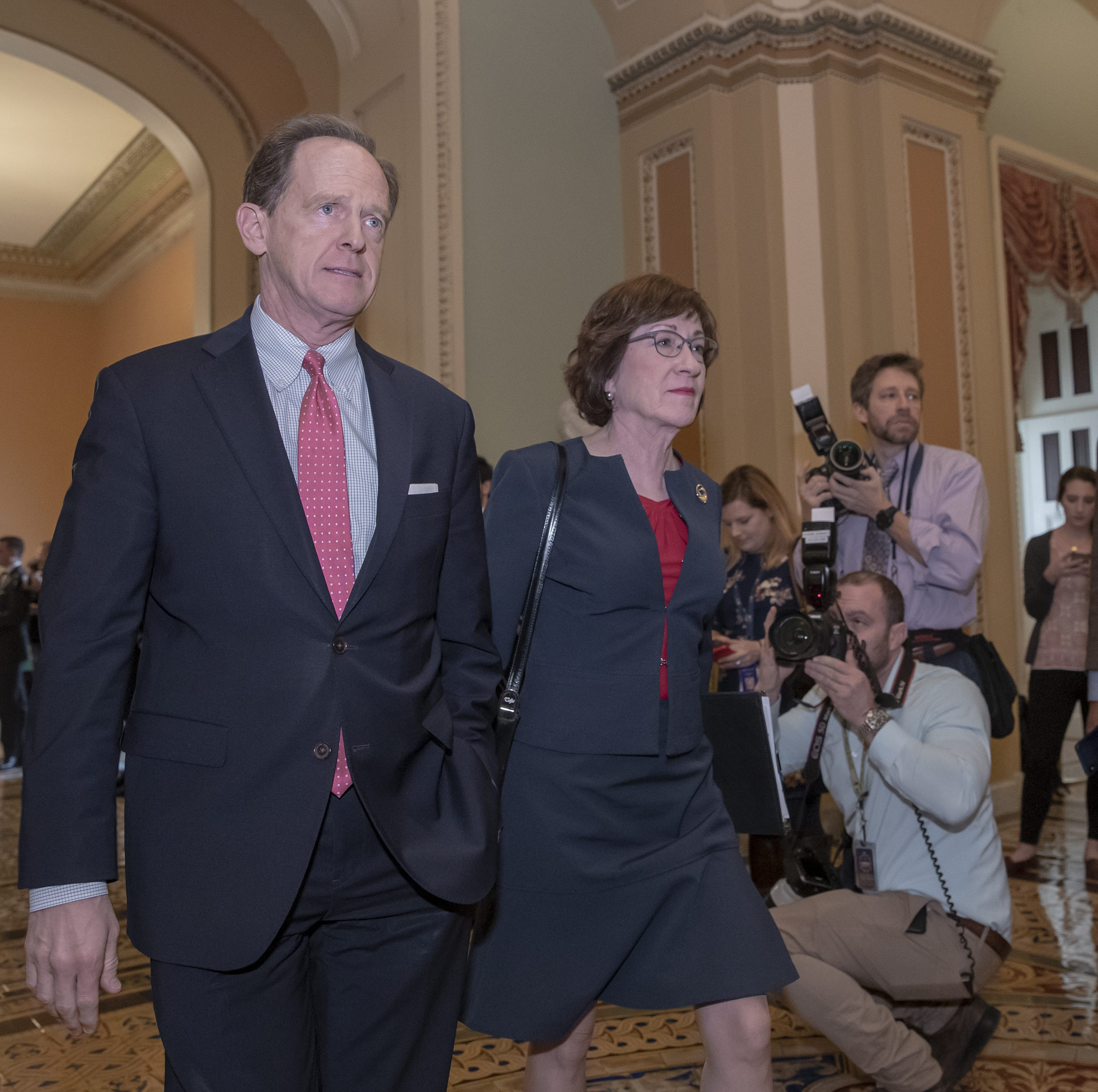 Sen. Pat Toomey, R-Pa., left, and Sen. Susan Collins, R-Maine, walk to the chamber for two votes that could end the government shutdown, at the Capitol in Washington, Thursday, Jan. 24, 2019. Both measures failed, as the partial government shutdown continues. (AP Photo/J. Scott Applewhite)