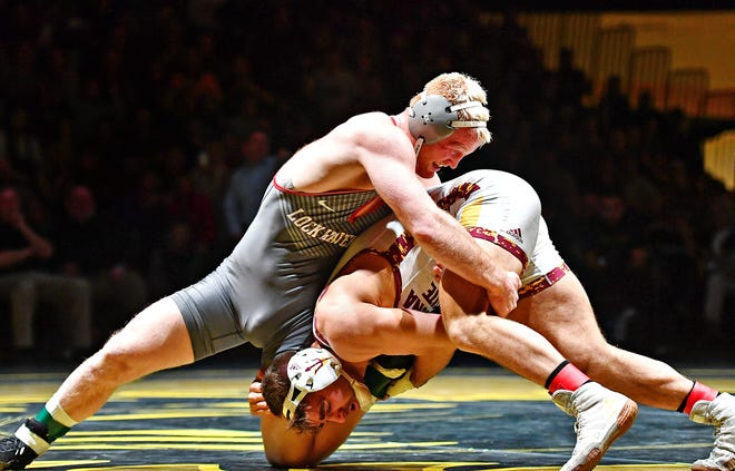 Lock Haven's Chance Marsteller wrestles Arizona State's Josh Shields in the 165 pound weight class during NCAA Division I wrestling wrestling action at Red Lion Area High School in Red Lion, Friday, Jan. 25, 2019. Shields would win the match. Dawn J. Sagert photo