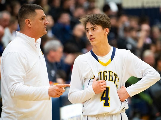 Eastern York's Trevor Seitz (4) talks strategy with Coach Seitz during the YAIAA boys' basketball game between Eastern York and West York, Friday, January 25, 2019. The Golden Knights defeated the Bulldogs 59 to 55.