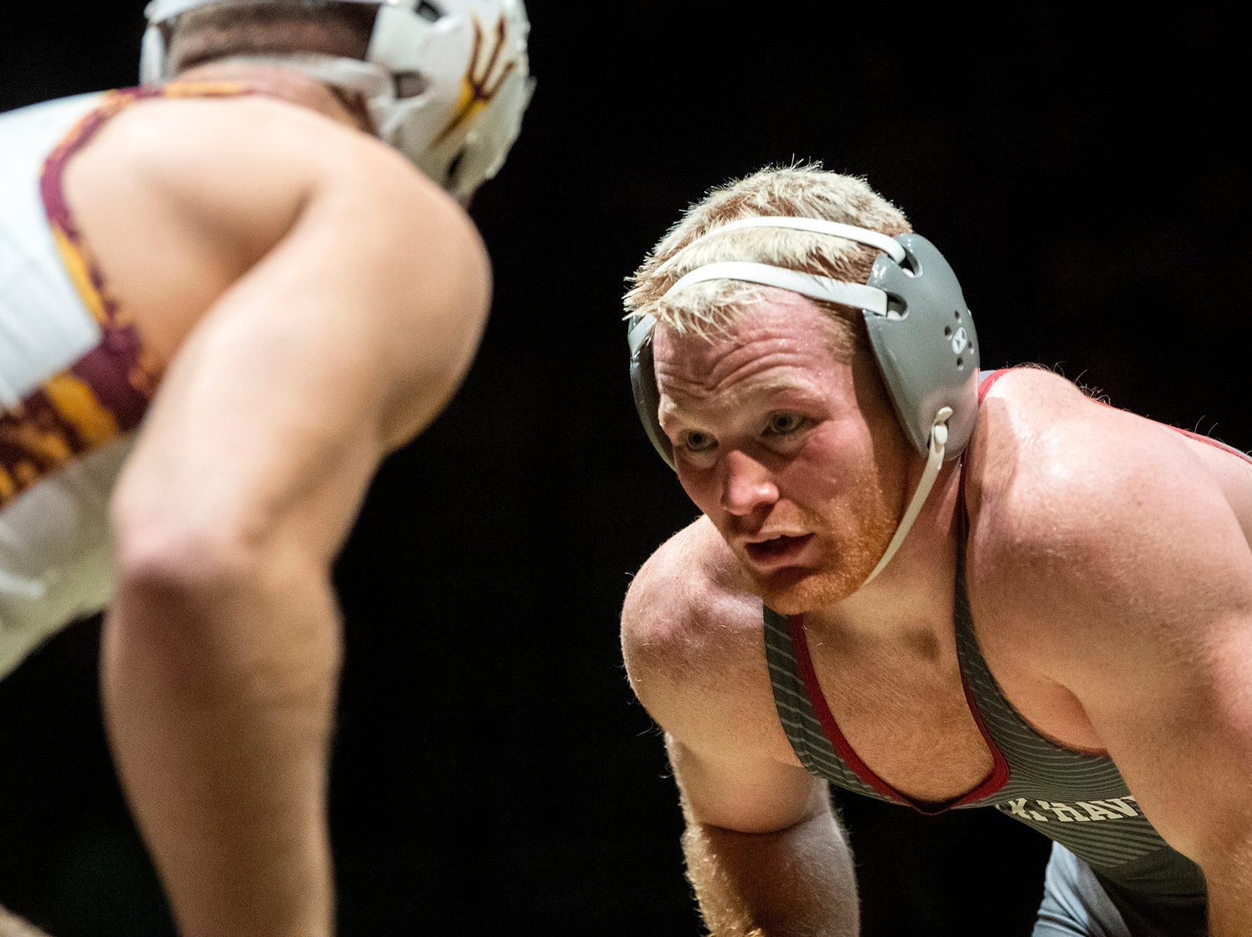 Lock Haven's Chance Marsteller, right, eyes up Arizona State's Josh Shields during the 165-pound bout at Red Lion's Fitzkee Athletic Center on Friday, Jan. 25, 2019. Shields (No. 5) beat Marsteller (No. 4), 2-1, in a tiebreaker. No. 22 Lock Haven upset No. 12 Arizona State, 23-14, in the first ever 'Rumble in the Jungle.'