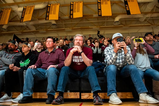 Lock Haven fans watch on as nationally ranked Chance Marsteller (No. 4) takes on Arizona State's Josh Shields (No. 5) during overtime in the 165-pound bout at Red Lion's Fitzkee Athletic Center on Friday, Jan. 25, 2019. Shields beat Marsteller, 2-1, via tiebreaker. No. 22 Lock Haven upset No. 12 Arizona State, 23-14, in the first ever 'Rumble in the Jungle.'