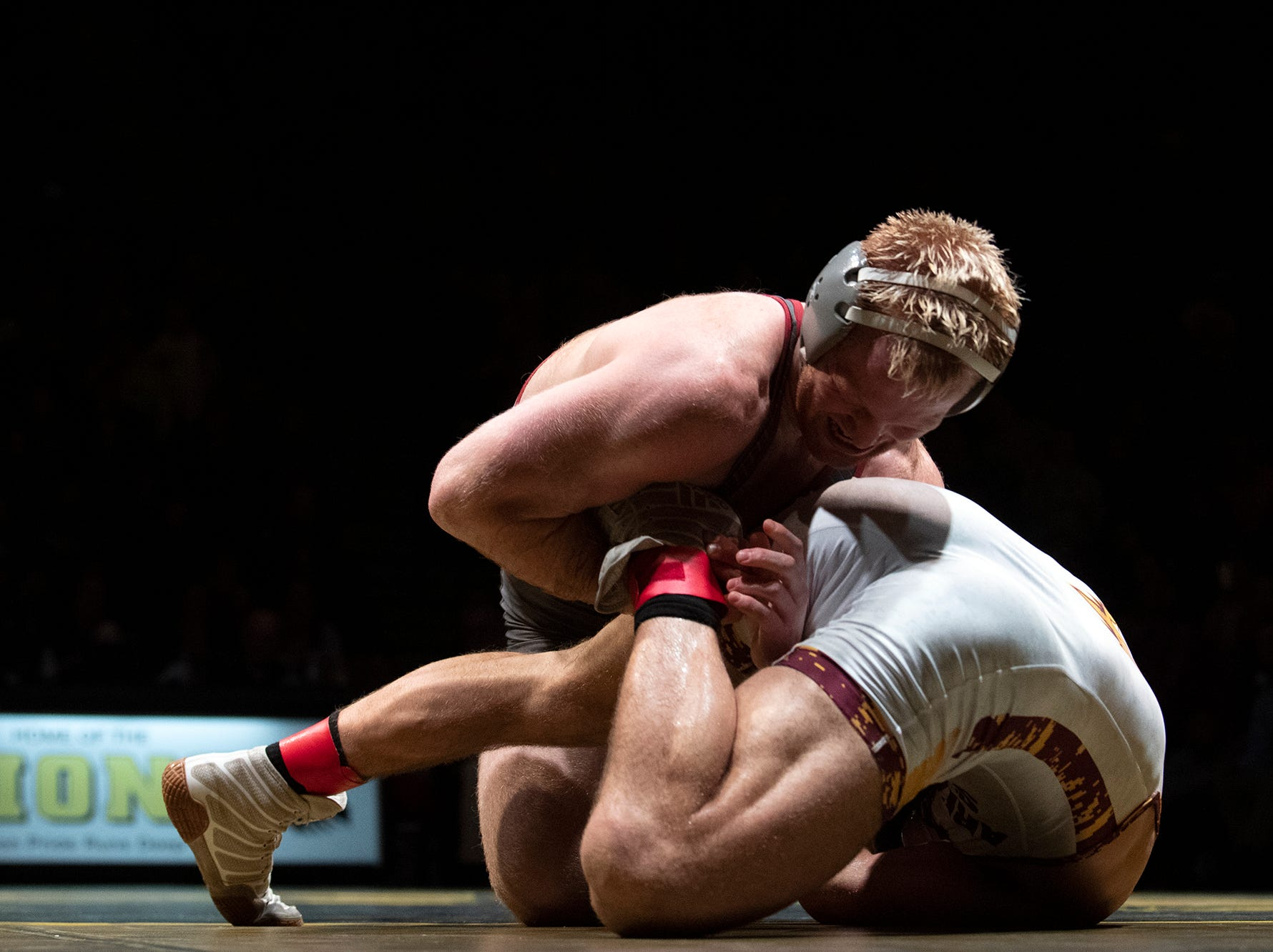 Lock Haven's Chance Marsteller, top, wrestles with Arizona State's Josh Shields during the 165-pound bout at Red Lion's Fitzkee Athletic Center on Friday, Jan. 25, 2019. Shields (No. 5) beat Marsteller (No. 4), 2-1, in a tiebreaker. No. 22 Lock Haven upset No. 12 Arizona State, 23-14, in the first ever 'Rumble in the Jungle.'