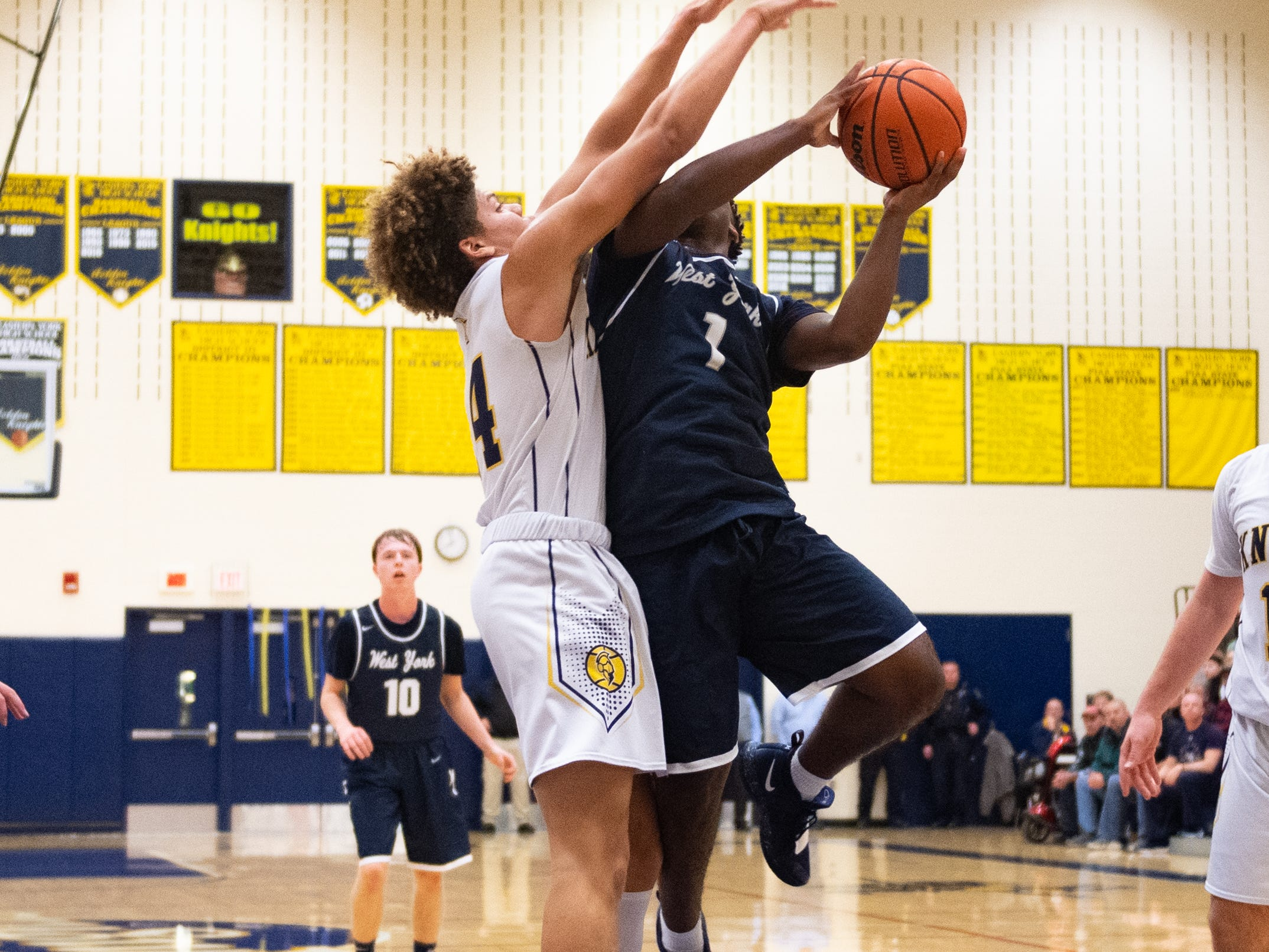 Demonte Martin (14) guards Kelvin Matthews (1) during the YAIAA boys' basketball game between Eastern York and West York, Friday, January 25, 2019 at Eastern York High School. The Golden Knights defeated the Bulldogs 59 to 55.