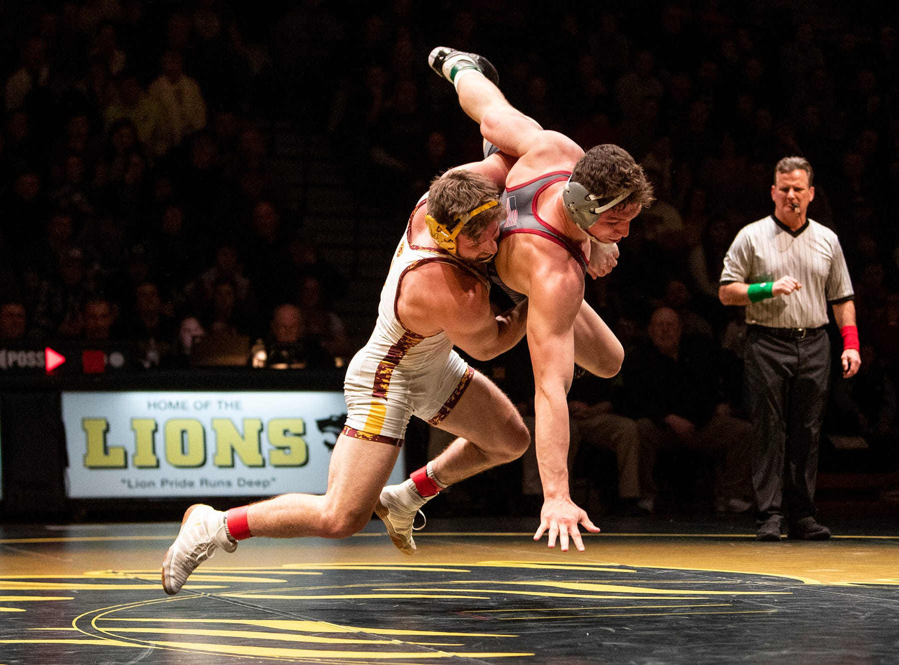 Arizona State's Austyn Harris, left, returns Lock Haven's Parker McClellan to the mat during the 197-pound bout at Red Lion's Fitzkee Athletic Center on Friday, Jan. 25, 2019. McClellan beat Harris, 2-1, as No. 22 Lock Haven upset No. 12 Arizona State, 23-14, in the first ever 'Rumble in the Jungle.'