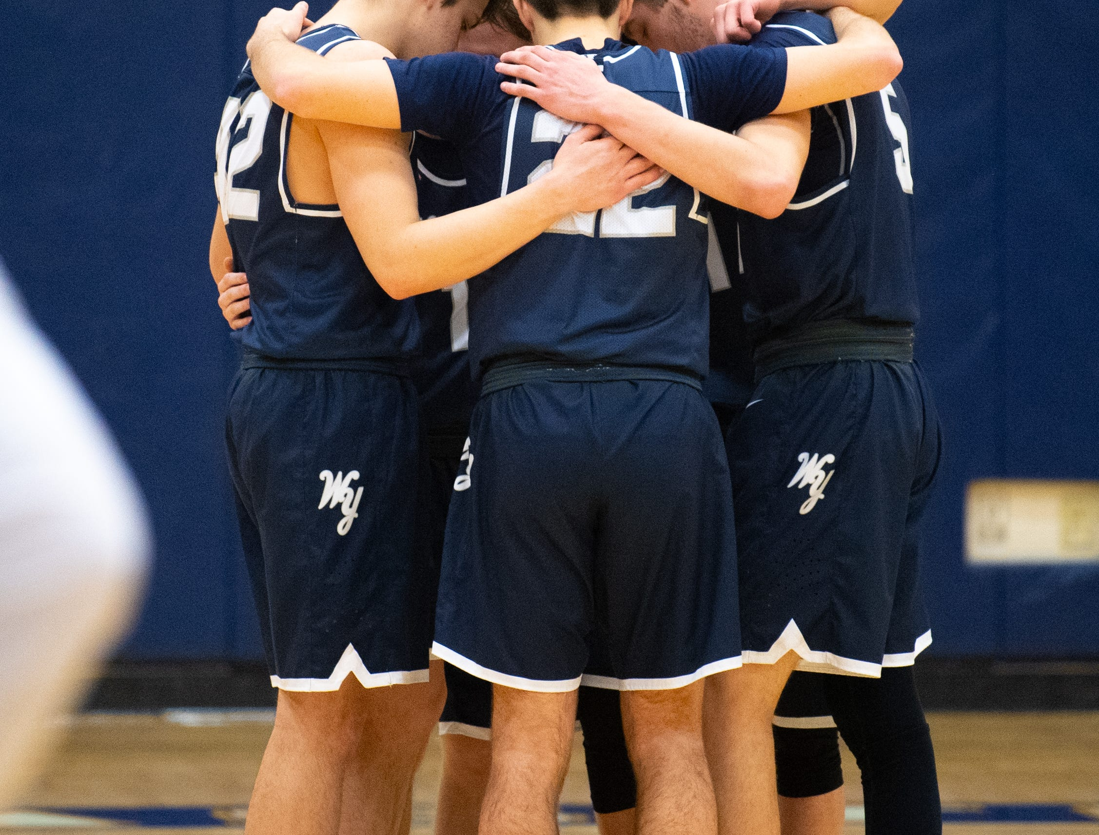 West York's starters gather together during the YAIAA boys' basketball game between Eastern York and West York, Friday, January 25, 2019. The Golden Knights defeated the Bulldogs 59 to 55.