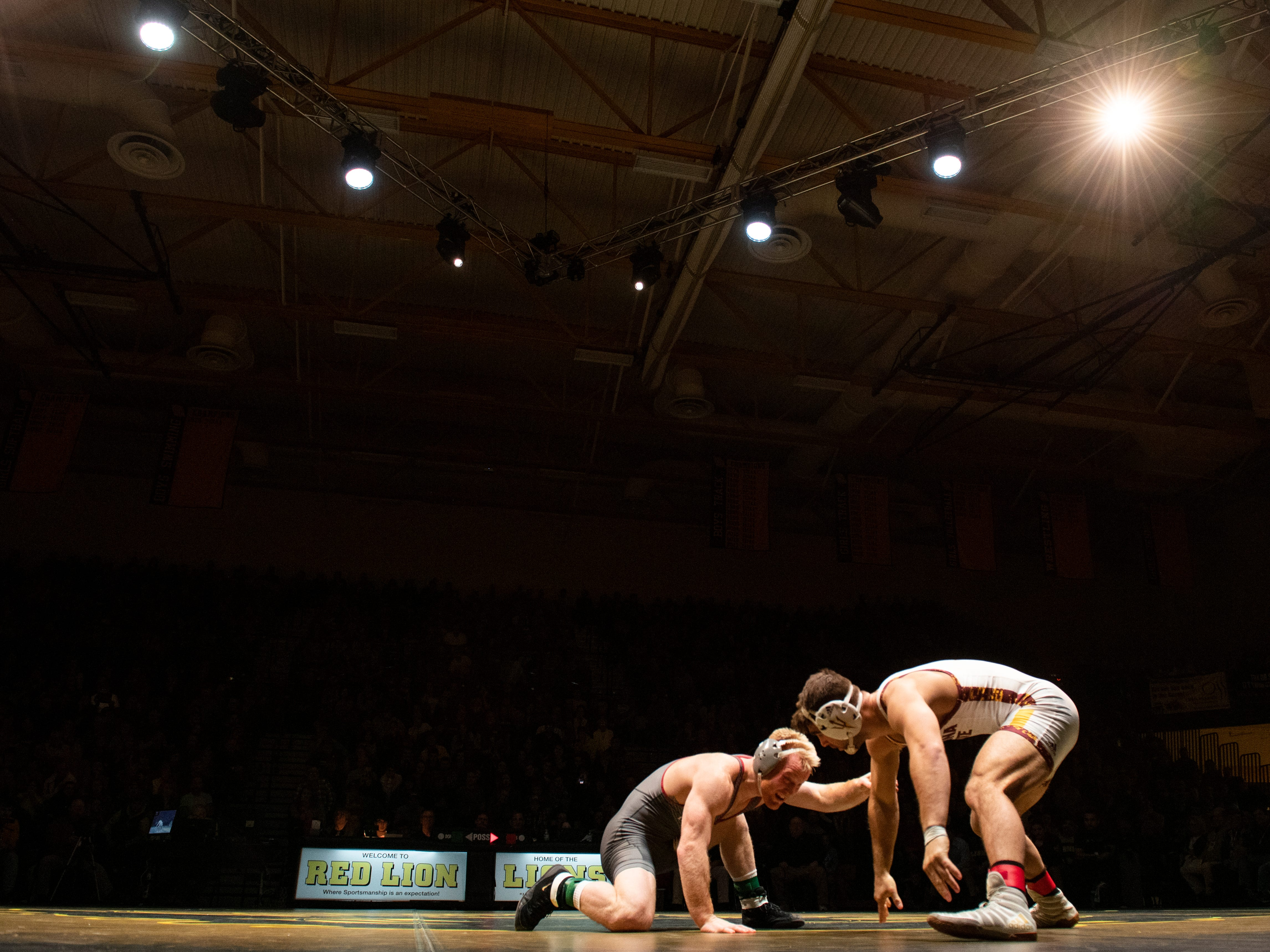 Lock Haven's Chance Marsteller, left, wrestles with Arizona State's Josh Shields during the 165-pound bout at Red Lion's Fitzkee Athletic Center on Friday, Jan. 25, 2019. Shields, nationally ranked at No. 5, beat Marsteller (No. 4), 2-1, in a tiebreaker. No. 22 Lock Haven upset No. 12 Arizona State, 23-14, in the first ever 'Rumble in the Jungle.'