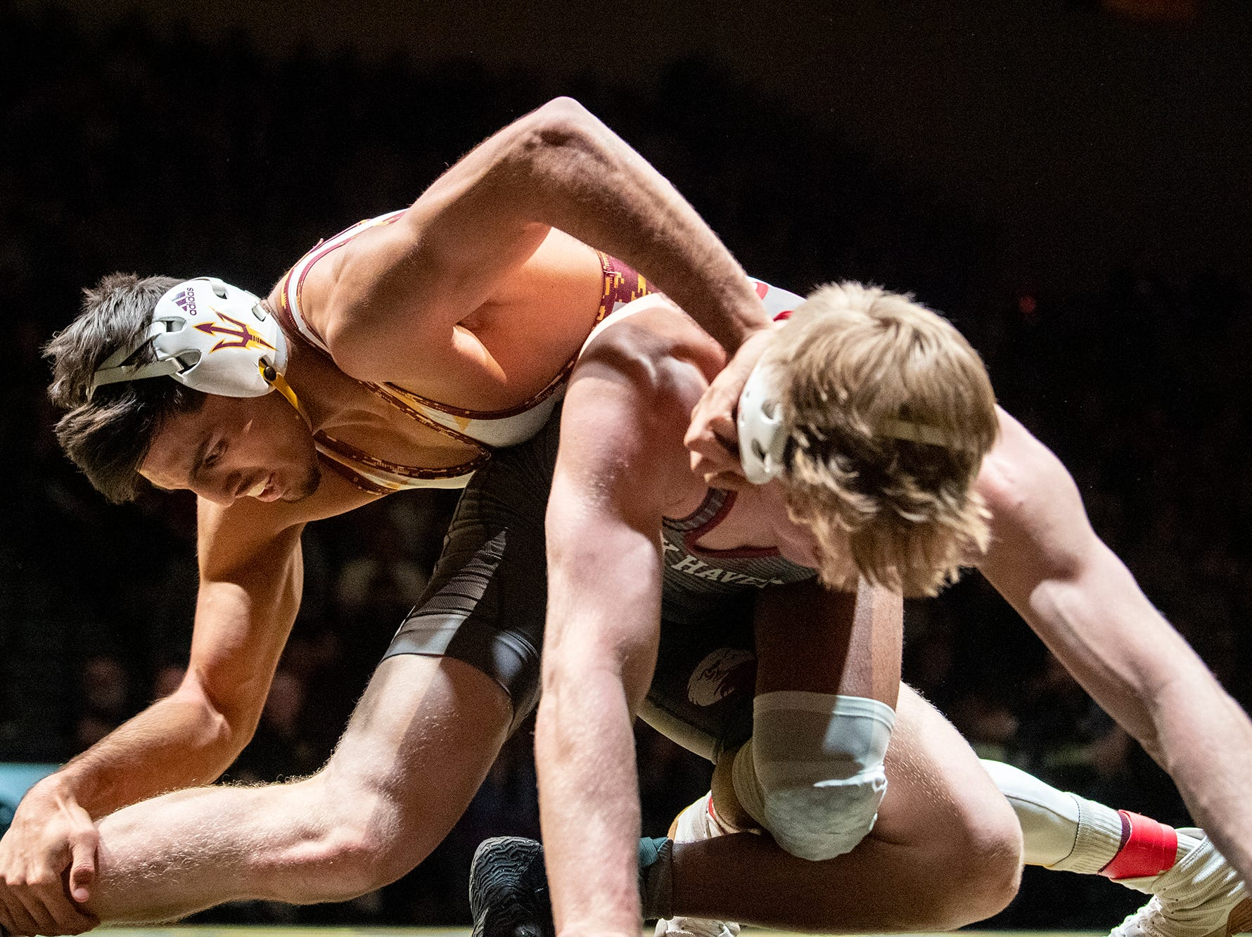 Arizona State's Zahid Valencia, left, wrestles Lock Haven's Jared Siegrist during the 174-pound bout at Red Lion's Fitzkee Athletic Center on Friday, Jan. 25, 2019. Valencia beat Siegrist, 14-4. No. 22 Lock Haven upset No. 12 Arizona State, 23-14, in the first ever 'Rumble in the Jungle.'