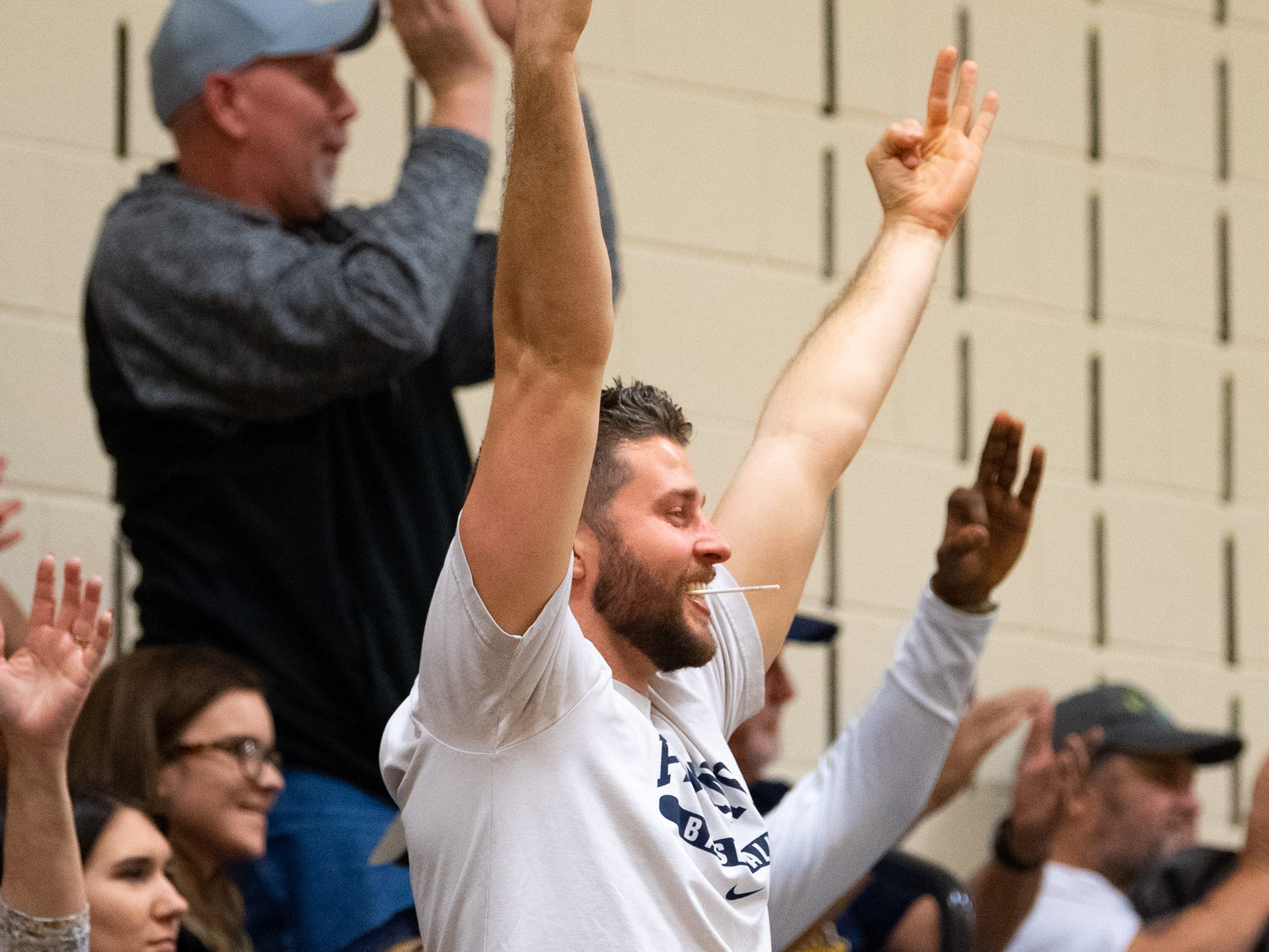 Eastern York fans celebrate a made three-pointer during the YAIAA boys' basketball game between Eastern York and West York, Friday, January 25, 2019. The Golden Knights defeated the Bulldogs 59 to 55.