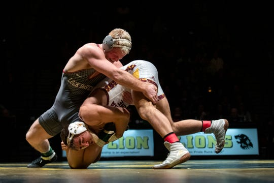 Lock Haven's Chance Marsteller, left, grapples with Arizona State's Josh Shields during the 165-pound bout at Red Lion's Fitzkee Athletic Center on Friday, Jan. 25, 2019. Shields, nationally ranked at No. 5, topped Marsteller (No. 4), 2-1, in a tiebreaker. Despite the loss, No. 22 Lock Haven upset No. 12 Arizona State, 23-14, in the first ever 'Rumble in the Jungle.'